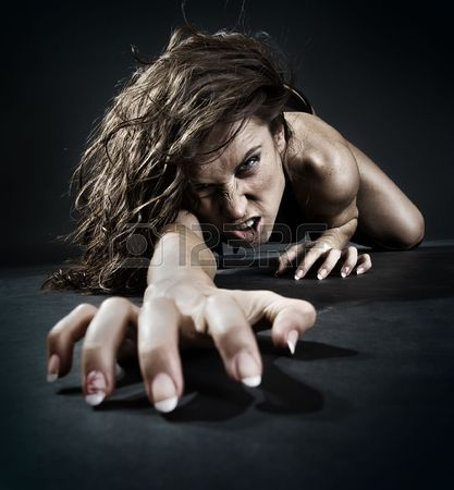evil-woman-creeping-from-dark